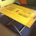 A 16th c folding table with carved and painted game boards
